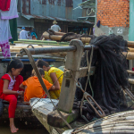 Kids at a Floating Market in the Mekong Delta